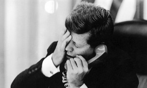 President John F. Kennedy reacts to news of the assassination of Congo's nationalist leader Patrice Lumumba in February 1961. (Photo credit: Jacques Lowe)
