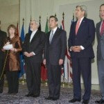 Secretary of State John Kerry (third from right) with other diplomats who negotiated an interim agreement with Iran on its nuclear program, including Iranian Foreign Minister Javad Zarif, (fifth from the right) . (Photo credit: State Department)