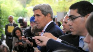 Secretary of State John Kerry addresses reporters in Geneva on Nov. 8, 2013, (Photo credit: State Department)
