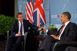 U.S. President Barack Obama and British Prime Minister David Cameron trade bottles of beer to settle a bet they made on the U.S. vs. England World Cup Soccer game (which ended in a tie), during a bilateral meeting at the G20 Summit in Toronto, Canada, June 26, 2010. (White House photo by Pete Souza)