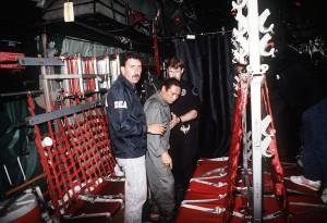 As an example of a U.S.-trained military officer gone bad, Gen. Manuel Noriega is escorted onto a U.S. Air Force aircraft by agents from the U.S. Drug Enforcement Agency after his arrest on Jan. 1, 1990. (U.S. military photo)