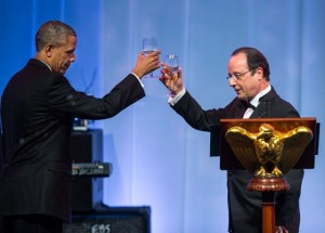 President Barack Obama raises his glass in a toast with President François Hollande of France during the State Dinner at the White House, Feb. 11, 2014. (Official White House Photo by Amanda Lucidon)