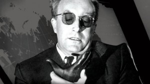 Peter Sellers playing Dr. Strangelove as he struggles to control his right arm from making a Nazi salute.