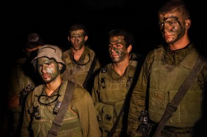 Soldiers from the Israeli Defense Forces prepare for the invasion of Gaza, as the second phase of Operation Protective E