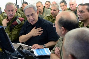 Prime Minister Benjamin Netanyahu held a security meeting with senior Israeli Defense Forces commanders near Gaza on July 21, 2014. (Israel government photo)