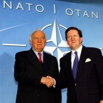 Eduard Shevardnadze, as president of Georgia in 2002, being welcomed to NATO by NATO Secretary General, Lord Robertson. (Credit: NATO photo)