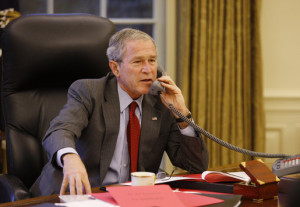 President George W. Bush speaks on the phone in the Oval Office, Oct. 7, 2008, with Prime Minister Gordon Brown of the United Kingdom, discussing efforts to solve the spreading global financial crisis. (White House photo by Eric Draper)