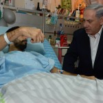 Israeli Prime Minister Benjamin Netanyahu visits with wounded Israeli soldiers during Israel's 2014 assault on and bombardment of Gaza. (Israeli government photo)