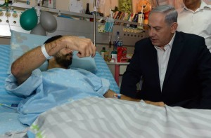 Israeli Prime Minister Benjamin Netanyahu visits with wounded Israeli soldiers. (Israeli government photo)
