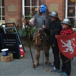 """Scottish street musicians including one in costume as William Wallace as portrayed in """"Braveheart"""" by Mel Gibson. (Photo credit: Don North)"""