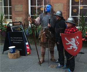 "Scottish street musicians including one in costume as William Wallace as portrayed in ""Braveheart"" by Mel Gibson. (Photo credit: Don North)"