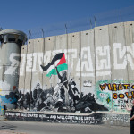 A portion of the separation wall built by the Israeli government jutting into the town of Bethlehem to enclose the tomb of Rachel within the Israeli zone.  Many portions of the wall contain graffiti and artwork by the Palestinians and their visitors. (Photo credit: Ted Lieverman)
