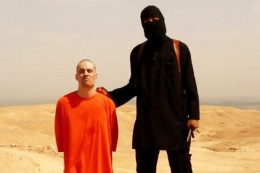 Journalist James Foley shortly before he was executed by an Islamic State operative, known as Jihadi John and identified as Mohammed Emwazi, the target of a drone attack that the Pentagon announced on Thursday.