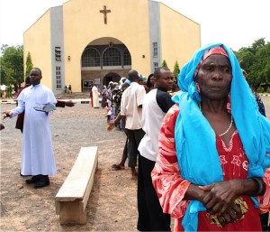 Nigerian refugees from the fighting with Boko Haram line up for relief supplies outside a Catholic Church. (Photo by Don North)