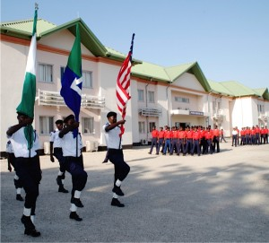 The Nigerian and U.S. flags carried together in parade on the campus of the American University of NIgeria in Yola, celebrating AUN's tenth anniversary. (Photo credit: Don North)