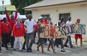 "AUN President Margee Ensign (on left in orange jersey) marches with students in a protest to ""Bring Back Our Girls."" (Photo by Don North)"