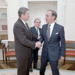 President Ronald Reagan meeting with media magnate Rupert Murdoch in the Oval Office on Jan. 18, 1983, with Charles Wick, director of the U.S. Information Agency, the the background. (Credit: Reagan presidential library)