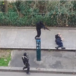 Islamic terrorists prepare to execute a wounded policeman after their attack on the offices of French magazine Charlie Hebdo on Jan. 7, 2015.