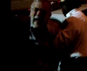 Ex-CIA analyst Ray McGovern crying out in pain while being arrested on Oct. 30, 2014, in New York City. (A screenshot via The Dissenter at firedoglake.com)