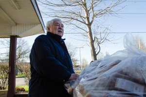 Don Luce helps unload food at the Mission's kitchen.  At least 5 days a week, Luce and a helper drive the dilapidated Mission pick-up truck to supermarkets and restaurants in Niagara Falls that donate food to the soup kitchen. (Photo credit: Ted Lieverman)