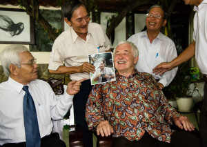 After a dinner given in Luce's honor in Saigon in May 2013, he sits surrounded by Do Van Minh, Dao Duy Nghe and Nguyen Van Ca.  Nghe and Ca were prisoners in the tiger cages in 1970 on the day Luce and the Congressmen visited and spoke to them.  Nghe is holding a photo of Luce from his much younger days in Vietnam, and they are laughing at how portly he has become. (Photo credit: Ted Lieverman)