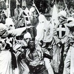 "A scene from ""The Birth of a Nation,"" D.W. Griffith's 1915, silent movie classic, depicting the ""renegade Negro,"" Gus, played by white actor Walter Long in blackface, in the hands of the Klan. (Photo credit: Museum of Modern Art, Film Stills Archive.)"