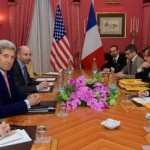 Secretary of State John Kerry meets with his diplomatic team and their French counterparts during negotiations with Iran over its nuclear program in Switzerland on March 28, 2015. (State Department photo)