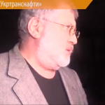 Ukrainian oligarch Igor Kolomoisky confronting journalists after he led an armed team in a raid at the government-owned energy company on March 19, 2015. (Screen shot from YouTube)