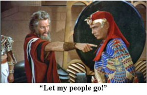 "Charlton Heston (as Moses) confronting Yul Brynner (as the Pharaoh) in ""The Ten Commandments."""
