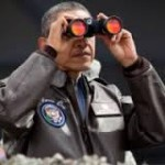 Near the ceasefire line between North and South Korea, President Barack Obama uses binoculars to view the DMZ from Camp Bonifas, March 25, 2012. (Official White House Photo by Pete Souza)
