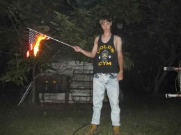 Accused mass murderer and white supremacist Dylann Roof shown burning an American flag.