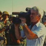 An ABC News cameraman in the Persian Gulf War films the arrival of Syrian troops. (Photo credit: Don North)