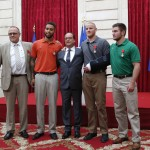 French President Francois Hollande, center, with British businessman Chris Norman, left, U.S. student Anthony Sadler, U.S. Airman First Class Spencer Stone and