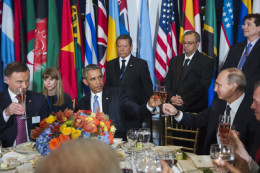 United States President Barack Obama (third from left) and Vladimir V. Putin (second from right), President of the Russian Federation, share a toast at a luncheon hosted by Secretary-General Ban Ki-moon in honor of world leaders attending the general debate of the General Assembly. Also pictured: Andrzej Duda (left), President of the Republic of Poland.