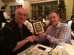 Sam Parry (right) receiving the 2015 Gary Webb Freedom of the Press Award on Dec. 17, 2015, from journalist Martin Kilian, treasurer of Consortium for Independent Journalism.