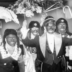 "An historical photo of ""black-face"" participants in a Mummers Parade."