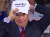 """Alabama Sen. Jeff Sessions donning one of Donald Trump's """"Make America Great Again"""" caps."""