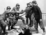 American and Soviet troops symbolically shake hands across the Elbe River on April 25, 1945, in the final days of World War II in Europe.