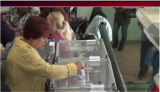 A Ukrainian woman voting in the May 11, 2014 referendum on independence for sections of eastern Ukraine. (Screen shot from RT video)