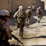 U.S. Marines patrol street in Shah Karez in Helmand Province, Afghanistan, on Feb. 10. (U.S. Marine Corps photo by Staff Sgt. Robert Storm)