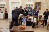 "President Barack Obama and a boy from the education documentary ""Waiting for Superman"" fist-bump in the Oval Office, Oct. 11, 2010. (Official White House Photo by Pete Souza)"