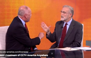 "Former Rep. Pete Hoekstra (left) argues with ex-CIA analyst Ray McGovern about the Senate torture report on CCTV America's ""The Heat"" on Dec. 11, 2014. (Screenshot from program)"