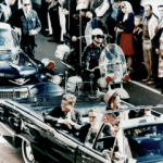 President John F. Kennedy in the motorcade through Dallas shortly before his assassination on Nov. 22, 1963. (Photo credit: Walt Cisco, Dallas Morning News)