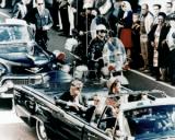 President John F. Kennedy in the motorcade through Dallas shortly before his assassination on Nov. 22, 1963. (Photo credit: Walt Cisco, Dallas Morning News)