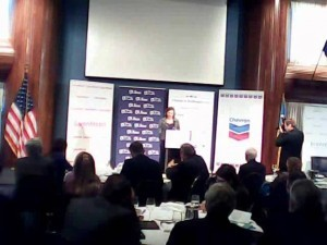A screen shot of U.S. Assistant Secretary of State for European Affairs Victoria Nuland speaking to U.S. and Ukrainian business leaders on Dec. 13, 2013, at an event sponsored by Chevron, with its logo to Nuland's left.