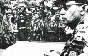 General Suharto attending the funerals of murdered Indonesian generals in October 1965.