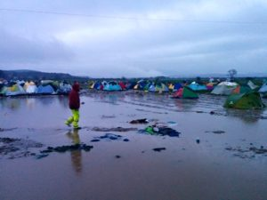 A rain-soaked camp for Mideast war refugees near the Greek-Macedonian border.