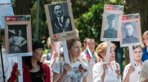 Russian marchers honoring family members who fought in World War II. (Photo from RT)
