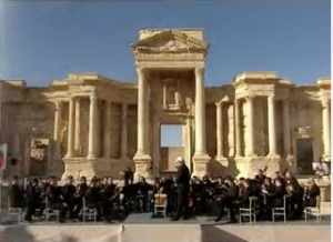 A Russian orchestra performs a concert at Palmyra's ancient Roman theater on May 5, 2016, after Syrian troops, backed by Russian air power, reclaimed the ancient city from the Islamic State. (Image from RT's live-streaming of the event)