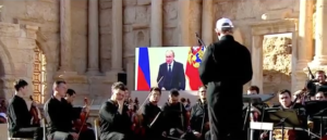 Russian President Vladimir Putin addressing the audience at a concert for Palmyra via a satellite link on May 5, 2016. (Image from RT's live-streaming of the event)